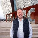 Belfast landmark: Joe Swail outside the Titanic Centre ahead of one of his coaching sessions