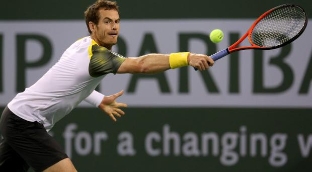 INDIAN WELLS, CA - MARCH 12: Andy Murray of Great Britain hits a return to Yen-Hsen Lu of Chinese Taipei during day 7 of the BNP Paribas Open at Indian Wells Tennis Garden on March 12, 2013 in Indian Wells, California. (Photo by Stephen Dunn/Getty Images). (Photo by Stephen Dunn/Getty Images)