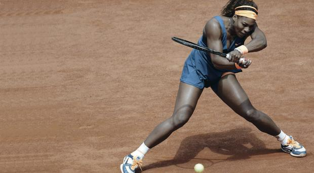 Serena Williams returns serve against Roberta Vinci at the French Open
