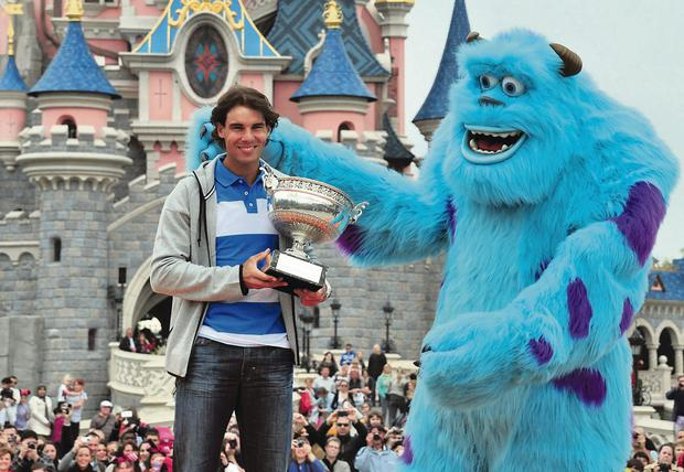Rafael Nadal celebrating his French Open victory with Sulley, from Monsters Inc. at Disneyland Paris