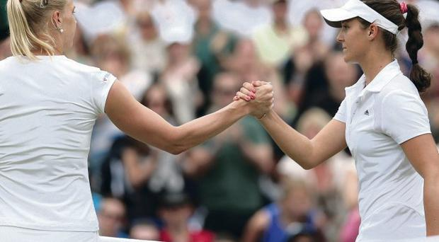 LONDON, ENGLAND - JULY 01: Kaia Kanepi of Estonia shakes hands at the net with Laura Robson of Great Britain after their Ladies' Singles fourth round match on day seven of the Wimbledon Lawn Tennis Championships at the All England Lawn Tennis and Croquet Club on July 1, 2013 in London, England. (Photo by Clive Brunskill/Getty Images)