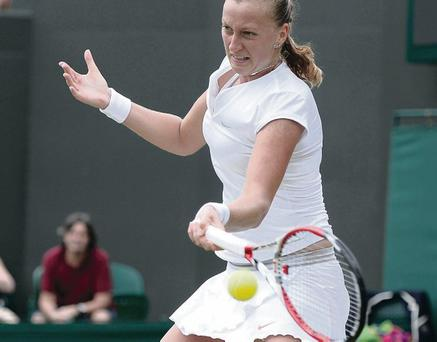LONDON, ENGLAND - JULY 01: Petra Kvitova of Czech Republic plays day seven of the Wimbledon Lawn Tennis Championships at the All England Lawn Tennis and Croquet Club on July 1, 2013 in London, England. (Photo by Dennis Grombkowski/Getty Images)