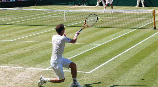 Andy Murray of Great Britain hits a forehand during the Gentlemen's Singles Final match against Novak Djokovic of Serbia on day thirteen of the Wimbledon Lawn Tennis Championships at the All England Lawn Tennis and Croquet Club on July 7, 2013