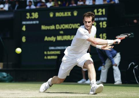 Andy Murray of Great Britain hits a backhand during the Gentlemen's Singles Final match against Novak Djokovic of Serbia on day thirteen of Wimbledon
