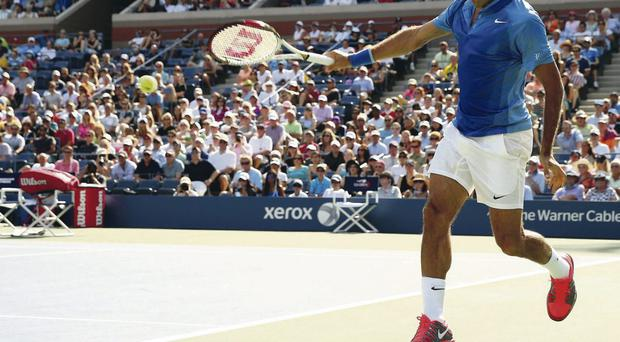Take off: Roger Federer made light work of Grega Zemlja at Flushing Meadows as he seeks to win the US Open for the sixth time