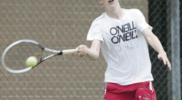 Tenacious: Ardghal Macmahon sealed his place in the under-16 and under-18 semi-finals with two hard-fought victories