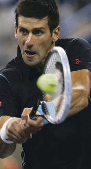 Class act: Novak Djokovic powers to victory over Mikhail Youzhny