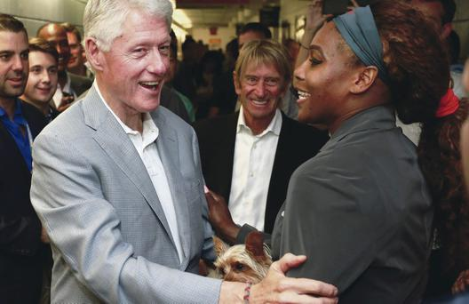 NEW YORK, NY - SEPTEMBER 08: (L-R) Former President Bill Clinton congratulates Serena Williams of the United States after her women's singles final victory on Day Fourteen of the 2013 US Open at the USTA Billie Jean King National Tennis Center on September 8, 2013 in New York City. (Photo by Chris Trotman/Getty Images for the USTA)