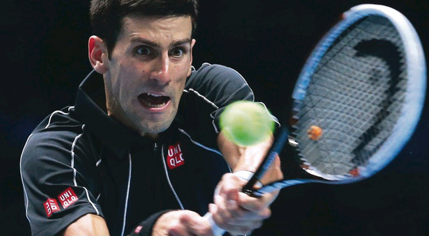 Novak Djokovic hits a backhand during last night's win