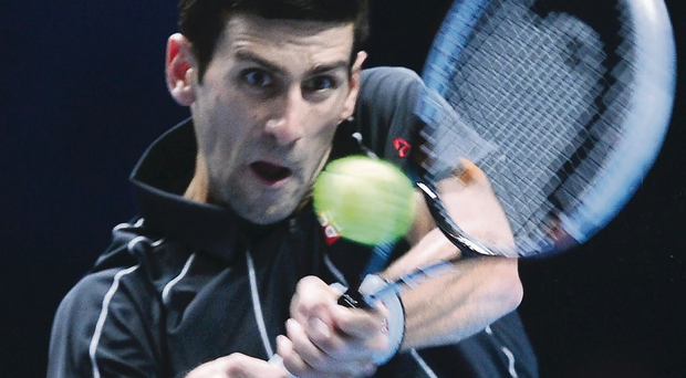 Class display: Novak Djokovic on his way to victory over Rafael Nadal in last night's final