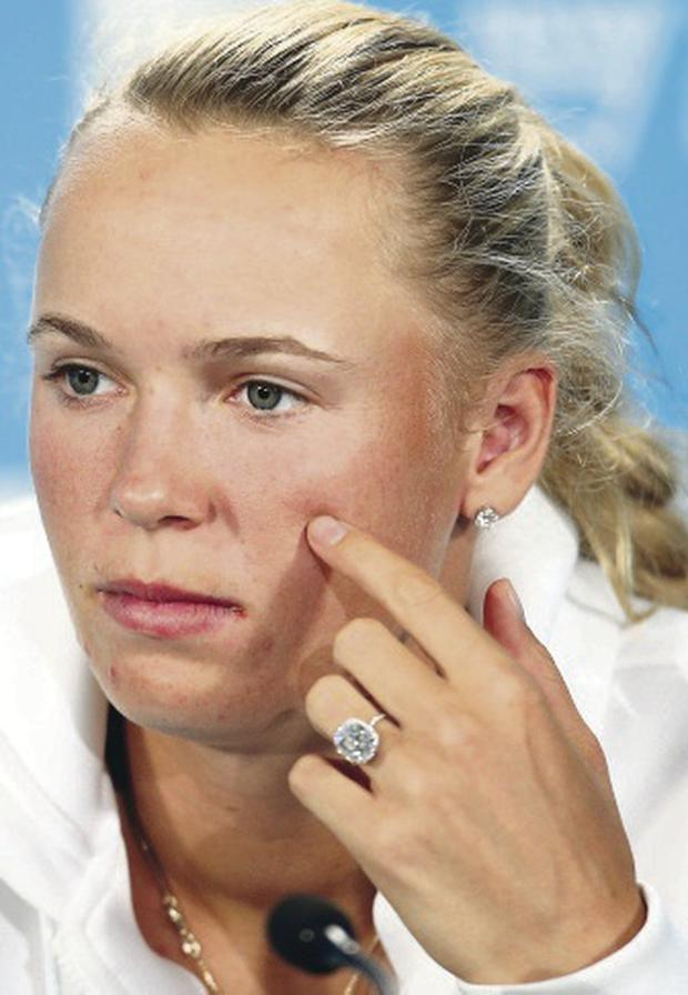Caroline Wozniacki was also troubled in round one