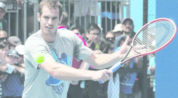 Andy Murray practises in Melbourne ahead of his last 16 match against Stephane Robert, the lowest ranked player left