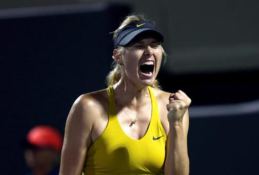 Maria Sharapova, from Russia, celebrates after winning a point in her match against Lucie Safarova during the Sony Open Tennis in Key Biscayne, Fl., Saturday, March 22, 2014. (AP Photo/J Pat Carter)