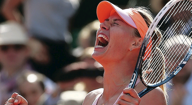 Open race: Maria Sharapova celebrates winning her women's singles semi-final match against Eugenie Bouchard at the French Open