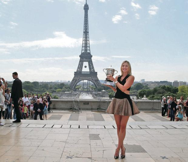 Towering achievement:Maria Sharapova shows off the trophy after her second win at the French Open in Paris