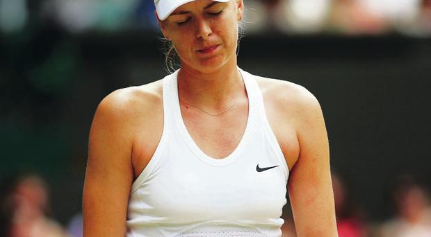 Going home: Reality begins to sink in for Maria Sharapova after the Russian was well beaten by Angelique Kerber