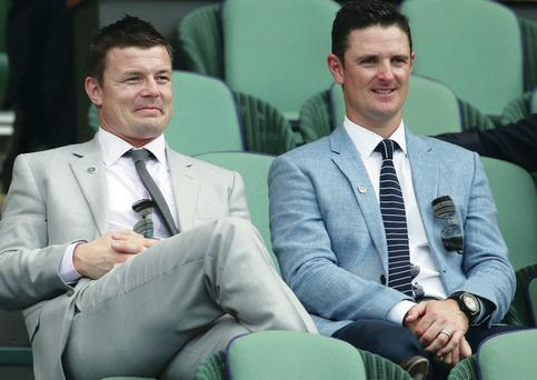 Good view: Brian O'Driscoll and Justin Rose (right) watch yesterday's action unfold from the Royal Box on Centre Court
