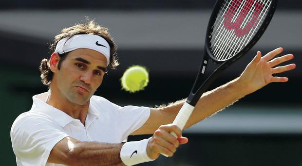 Marching on: Roger Federer sees off Milos Raonic yesterday