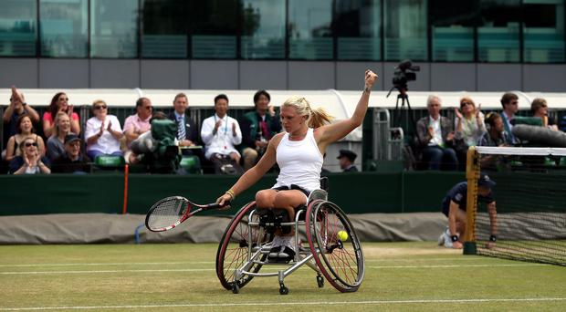 Great Britain's Jordanne Whiley in action in the Wheelchair Ladies Doubles Final with partner Japan's Yui Kamji against Netherland's Jiske Griffioen and Aniek Van Koot during day fourteen of the Wimbledon Championships at the All England Lawn Tennis and Croquet Club, Wimbledon. PRESS ASSOCIATION Photo. Picture date: Sunday July 6, 2014. See PA story TENNIS Wimbledon. Photo credit should read: John Walton/PA Wire. RESTRICTIONS: Editorial use only. No video emulation. No false commercial association. No manipulation of images. No use with any unofficial third party logos. No transmission of images to mobile services.