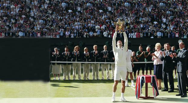 Epic win: Novak Djokovic celebrates defeating Roger Federer in the Mens' Singles Final yesterday