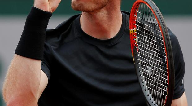 Game face: Andy Murray on way to victory over Portugal's Joao Sousa at the French Open in Paris