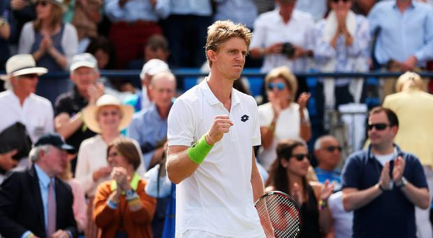 Net gain: Kevin Anderson on his way to a stunning win