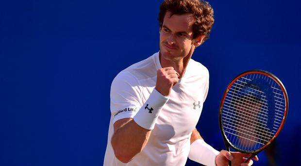 It's mine: Andy Murray typically salutes another point won in his quarter-final victory over Gilles Muller