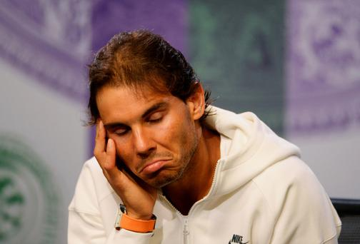 Glum faced ace: Rafael Nadal hasn't made it through to the fourth round at Wimbledon since reaching the final in 2011