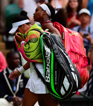 Emotional farewell: Heather Watson in tears after narrow defeat to Serena Williams