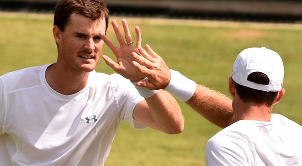 High five: Jamie Murray and partner John Peers will be aiming to reach the Wimbledon doubles final