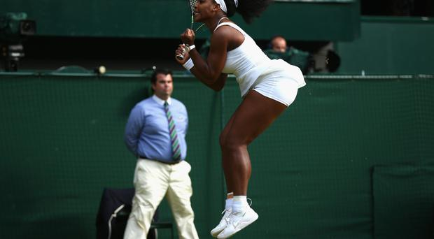 Glory shot: Serena Williams hopes to be jumping for joy today and she will be driven on by the painful memory of her loss to Garbine Muguruza at the French Open last year