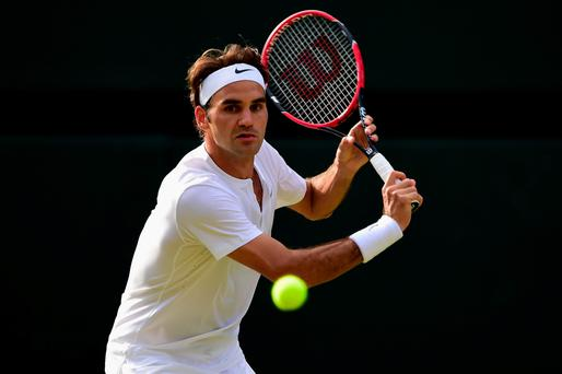 In the groove: Roger Federer takes aim