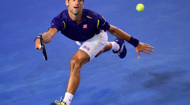 Taking victory in his stride: Novak Djokovic on his way to a 6-1 6-2 7-6 win over Quentin Halys at the Australian Open