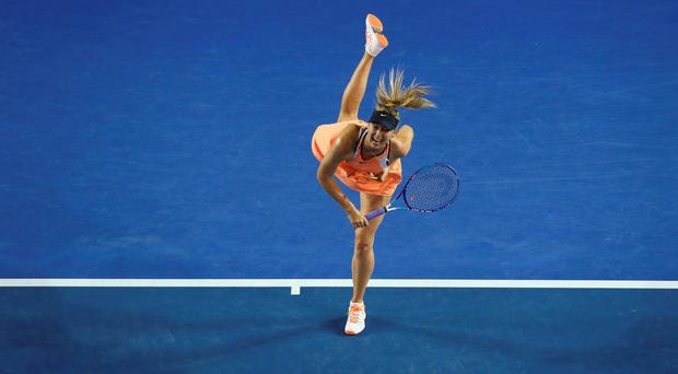 Maria Sharapova of Russia serves in her third round match against Lauren Davis