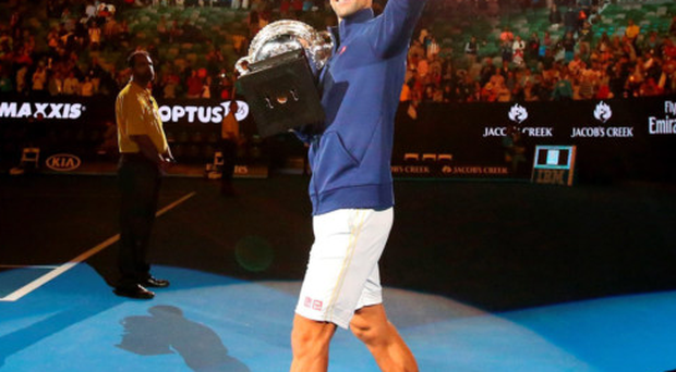 Crest of a wave: Novak Djokovic acknowledges the Melbourne crowd after winning his sixth Australian Open title and 11th Grand Slam overall