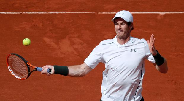 Ups and downs: Andy Murray was pleased with the heart he showed to fight back to beat Mathias Bourgue, but knows he won't last long in the French Open unless he does better