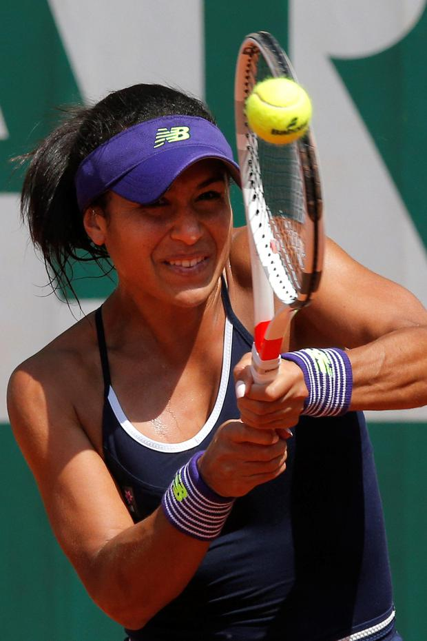 Off the pace: Heather Watson on her way to defeat at Roland Garros