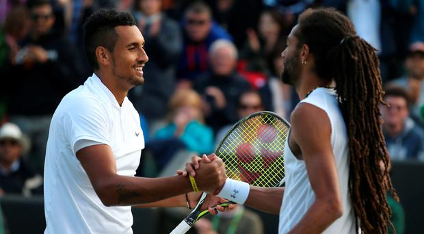 Well played: Nick Kyrgios and Dustin Brown shake hands after yesterday's entertaining match which was won by the Australian