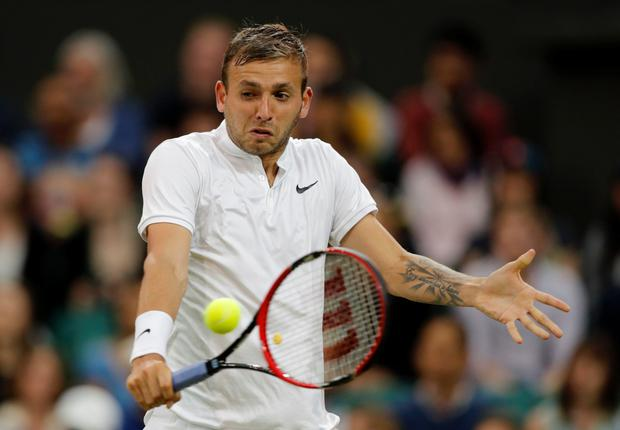 Rising star: Britain's Dan Evans returns to Roger Federer during his straight sets defeat to the 34-year-old Swiss grand master yesterday