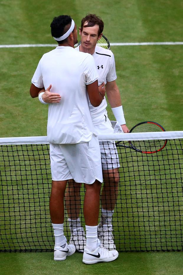 On a different level: Nick Kyrgios gets a hug from Andy Murray, but the Australian could have put up a much tougher fight on Centre Court