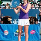 Honoured: Johanna Konta raises the Bank of the West Classic silverware