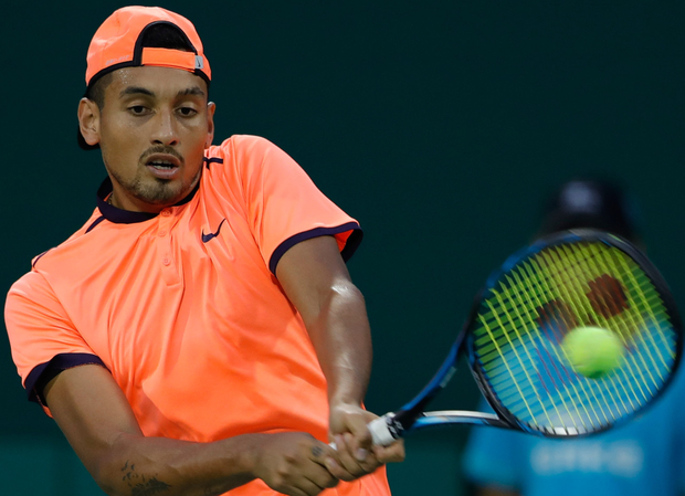 Hot water: Nick Kyrgios on his way to a highly controversial defeat to Mischa Zverev in the Shanghai Masters yesterday