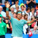 Happy return: Roger Federer celebrates victory in his comeback match against GB's Dan Evans in the Hopman Cup at Perth Arena