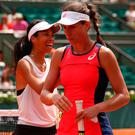 Johanna Konta of Great Britain and Su-Wei Hsieh of Taipei walk off court following the first round match on day three of the 2017 French Open at Roland Garros on May 30, 2017 in Paris, France.