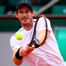 Big hit: Andy Murray is into the French Open quarter-finals despite his early struggles
