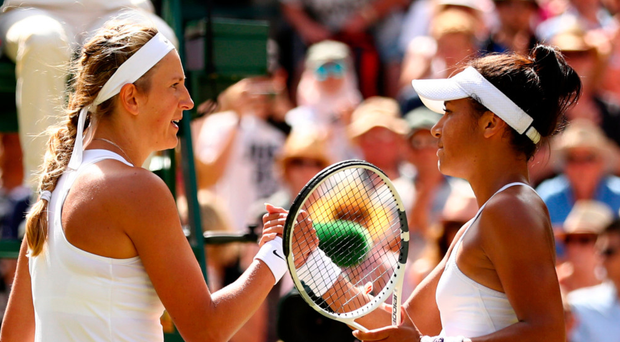 Tight battle: Victoria Azarenka and Heather Watson after the Belarusian's triumph on Centre Court
