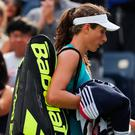Going home: Johanna Konta walks off court after losing in the first round of the US Open last night