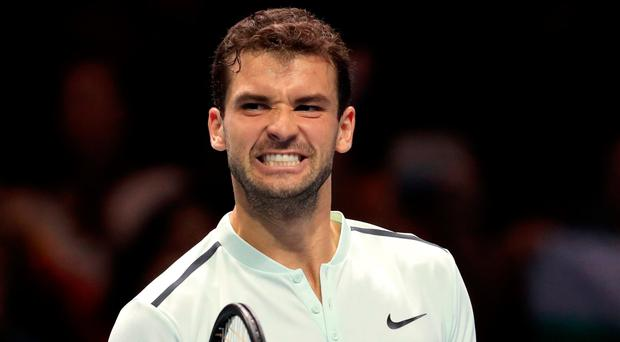 I feel good: Grigor Dimitrov celebrates victory over David Goffin at the O2 in London last night