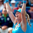 Triumph: Kiki Bertens celebrates surprise win over Simona Halep in Cincinatti
