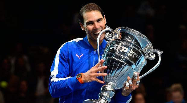 Taste of victory: Rafa Nadal celebrates with the trophy for ending the year as World No.1
